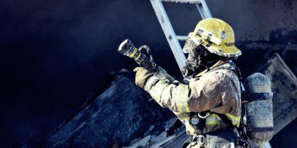 Firefighter In Equipment Preparing To Intervene
